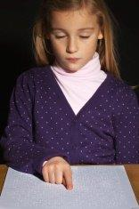picture of girl reading Braille